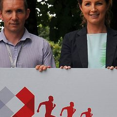 4 people holding a cheque for Touching Hearts